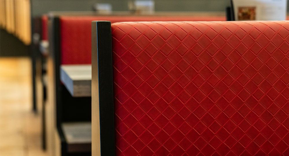 Skai® artificial leather in red and violet for the catering trade