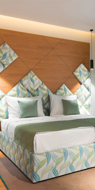 Bedroom design with individually printed artificial leather for wall coverings and bed parts